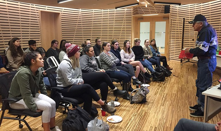 Louis Knapaysweet speaks to a group of undergraduate students about his experience as an Indigenous child who was interned at the notoriously violent St. Anne's Residential School in Fort Albany First Nation.